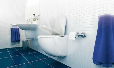 Toilette im Bad mit blauen Fliesen