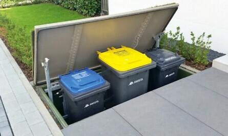 Tonnen im unterirdischen Mülltonnenhaus
